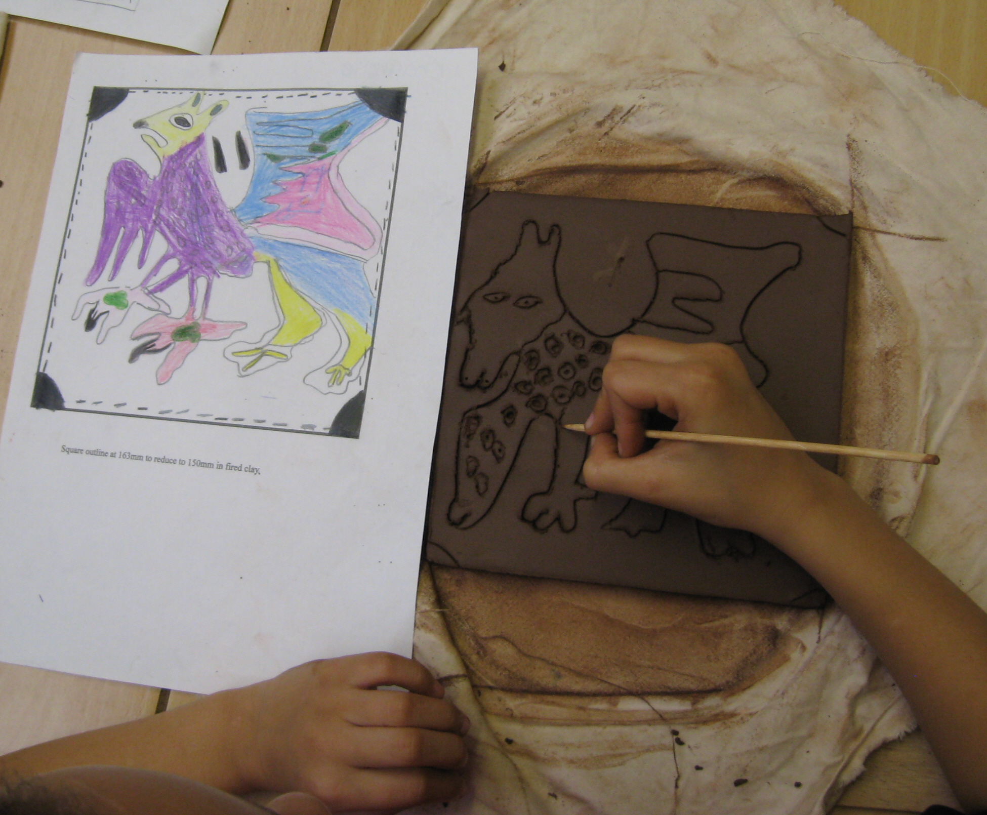 Child drawing Griffin tile